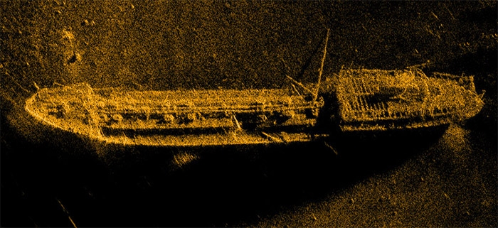"Made using the HUGIN 1000 AUV. Distance to the centre of the image is about 95m. The length of the wreck is about 68m and width about 9m. The wreck of the 1500 dwt oil tanker ""Holmengraa"" is lying on a slanted seabed at a depth of 77m."