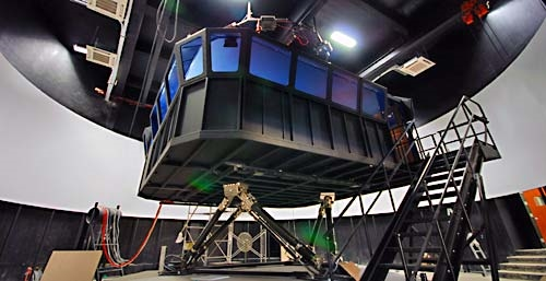 Polaris ship's bridge simulator with 360° visual screen on a pneumatic electric motion platform